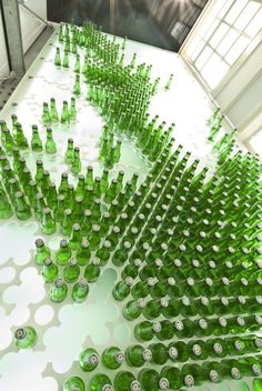 a way to display all the wine bottles...an art wall installation!