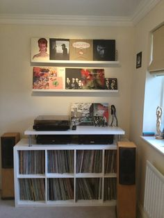 KALLAX for vinyl storage and an top shelf for players.