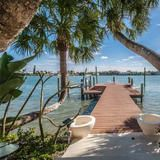 """You might describe this Clearwater Beach home as """"tropical luxury with high-tech toys."""" Water babies will be in heaven here, as there are plenty of options for swimming or just lounging alongside the beautiful clear blue waters.  