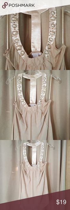 Beaded evening top This is a really pretty top. The front has a lot of beading. The front also has two different kinds of fabrics. Knit and sheer fabric. Charlotte Russe Tops Blouses