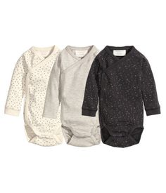 BABY EXCLUSIVE/CONSCIOUS. Long-sleeved, wrap-style bodysuits in soft organic cotton jersey. Snap fasteners along one side and at gusset.