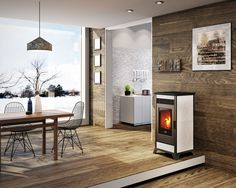 A nice burning Nordic Fire pellet stove in a room with a lot of wood. Pellet Fireplace, Pellet Stove, Earthship, Rave, Dining, Wood, Burns, Home Decor, Sevilla