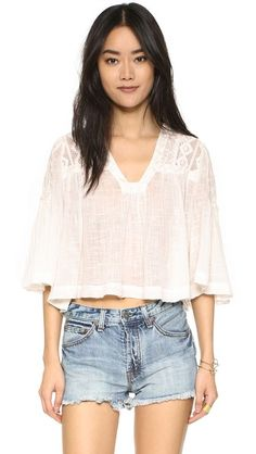 Beige Free people  crop top  for woman Feminine mixed lace composes the yoke of this relaxed Free People crop top. Deep V neckline. Flared 3/4 sleeves. Sheer. Fabric: Crinkled gauze. 100% cotton. Hand wash or dry clean. Imported, India. Measurements Length: 19.75in / 50cm, from shoulder Measurements from size S. Available sizes: L,M,S,XS #topcorto #bralet #strappybralet #bandeautop