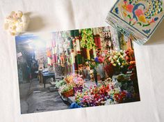 Print photograph of a Florist at a night market in Bangalore. Flowers and floral arrangement are a huge part of indian and hindu traditions, culture, and aesthetic. This print photograph is 18x24cm and it can be yours for 20€ only! Perfect for interior design and home decoration. Shop now at https://www.etsy.com/shop/AppealinWorld