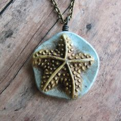 Sea Starfish Blue and Gold Pendant by DandyBeads on Etsy, $14.00