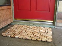 Recycled wine corks wired together into a doormat. This doormat measures 29 x 20 1/2 inches & is made up of 284 corks. Each cork has two holes drilled into it & they're laced together with steel wire.
