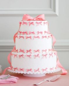 Pink Bow Wedding Cake  Attach tiny bows to pieces of floral wire and affix them to a white layer cake (remove them before slicing). Top off the cake with a larger version complete with flowing tails.