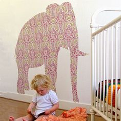 Cut out wallpaper in the shape of animals or something, make a wall decal cheap!