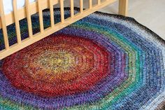 Sock Yarn Rug by chriss_coleman, via Flickr; Free Ravelry download: A basic pattern for a 10-sided rug out of large amounts of sock yarn scraps. The rug is crocheted with 8 strands of sock yarn held together -- it uses up yarn quickly.