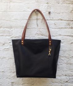There are plenty like this one up on our site so come check out all the cool designs for sell! #custom #handbags