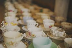 Find tea cups at thrift stores for the  guests to pick from and use at the wedding.  They would also make great favors to take home!