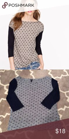 J. Crew Linen Colorblock Dot Top J. Crew linen tee with a dotted heathered design and solid three-quarter sleeves for a cool colorblock look. Made of pure linen, it also boasts a flattering drapey fit. Excellent used condition. J. Crew Tops