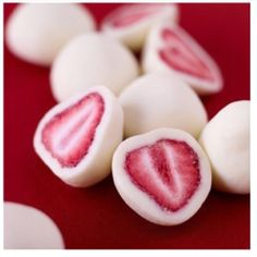 Dip strawberries in yogurt, freeze and you get this heathy yummy snack!