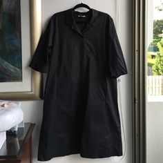 """Eileen Fisher Black Dress Size 1x Preowned Eileen Fisher Black Shirt Dress Size 1x. Button down. 22"""" pit to pit. 41"""" long. Sleeves can be cuffed. Two front pockets. 95% cotton and 5% spandex. Please look at pictures for better reference. Happy shopping!!! Eileen Fisher Dresses Midi"""