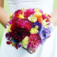 Shine with Jewel Tones  Jewel tones prevail in this bouquet of magenta dahlias, purple-blue hydrangeas, burnt-orange calla lilies, and yellow orchids. The dahlias and hydrangeas lend the arrangement a natural look. For a bouquet with a more formal feel, substitute roses for the dahlias.