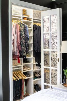 How we overhauled our small closets in our Master Bedroom with an improvised IKEA closet system rigging Billy bookcases and baskets for a perfectly organized wardrobe.