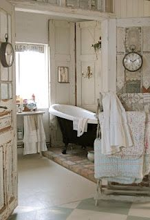 Love the glass doors, the old tub, the shutters against the wall, everything!