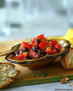 Liven up basic olive antipasto with garlic-and-thyme-infused olive oil and a handful of colorful salted tomatoes. Serve it with chunks of crusty bread. Tomato Appetizers, Appetizer Recipes, Betty Crocker, Best Christmas Appetizers, Antipasti Platter, Christmas Main Dishes, Antipasto Salad, Salads, Martha Stewart Recipes