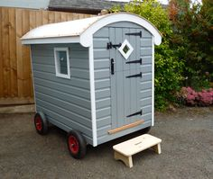 Shepherd's hut playhouse.  Small scale like a Wendy house.