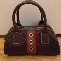 Tommy Hilfiger Double Handled Micro Bowling Bag Amazing Tommy Hilfiger micro bag! Gorgeous leather and perfect stitching. No marks inside or out. This bag is perfect for when you just want to go out and not carry a ton of stuff with you. Sorry to see this cute bag go! Tommy Hilfiger Bags