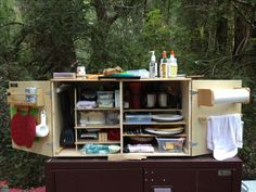 Camp Kitchen: Open would love to make this slide out of the back of the teardrop kitchen with legs on the end head height so it is like raised cabinets in a kitchen slide out table tops/counters underneath.
