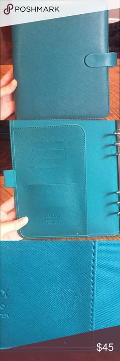 Filofax A5 Binder in Aquamarine Amazingly beautiful binder for your Filofax planner inserts! There is one small nick in the left side card slot panel's lower right. Does not come with any inserts! Other