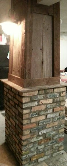 Pillar made out of old barn wood and bricks from an old industrial building. I like the framing of the wood