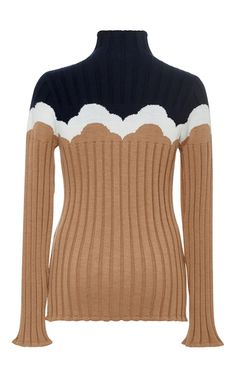 This **Parden's** Zevuda Ribbed Sweater features a turtleneck collar with color block design and a fitted silhouette.