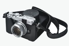 """Leather Case X20 for fuji x20. Made of premium, genuine leather that molds to your grip as it ages, this """"Quick Shot"""" case has an elegant design that integrates perfectly with the compact and lightweight camera body. Shoulder strap included. Leather case works with lens cap. http://zocko.it/LESE3"""