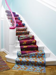 This is super cute, but a little dangerous to walk down! If you have bare stairs like this one then you can have a carpet runner especially for your staircase!    http://www.stair-rodsdirect.co.uk/    #stairs #rugs