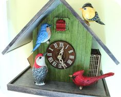 The Backyard Birds Cuckoo Clock is made in the Black Forest with birds hand carved in he U. Cuckoo Clocks, Backyard Birds, Blue Bird, Bird Feeders, Hand Carved, Carving, Sculpture, Outdoor Decor, Design