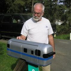 .I HOPE YOU'LL FOLLOW ANY OF MY 5 GREAT BOARDS CONCERNING THE POST OFFICE MAILMEN VEHICLES MAILBOXES AND OTHER THINGSit's a mailbox but it looks like a train.  -r.
