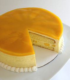 Glazed Mango Mousse Cake: priscilla's orange sponge cake mango mousse & mango chunks mango mirror glaze