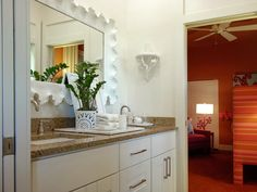 White and creams punctuate the color scheme of the HGTV Green Home 2009 child's bathroom, which serves the child's and guest's bedrooms.