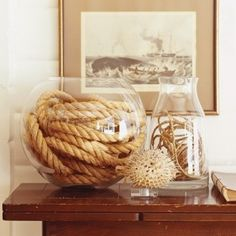 some rope in a bowl and a few other items give you ann instant Nautical theme