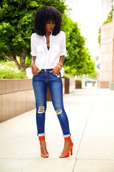 Jeans + button down shirt.  pop of color heels.  afro.  women's fashion and street style.