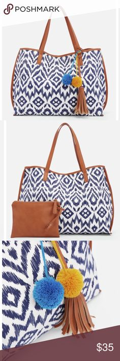 """🆕! NWT JustFab Dirk Tote NWT JustFab Dirk Tote in Blue. Say hello to your new fave tote! With just as much function as style, this baby is a total must! It features a beautiful bold print and faux leather top handles, and an inner faux leather zip pouch for extra storage. Material: Faux Leather Size: 17L x 13.5H x 5.5D Hardware color: Gold Shoulder drop measurement : 0"""" Removable Adjustable Shoulder Strap Pockets: 1 interior pocket, 1 interior zip Imported. In original packaging JustFab…"""