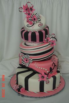 Pink and Black - Cake covered in fondant. Bugs and flowers are made with gumpaste.