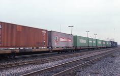 Conrail hauling the single-level containers--not the N&W.  That would be one of their TV's headed eastbound from Chicago to somewhere such as Croxton, New Jersey.