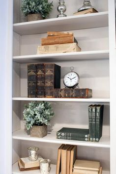 As seen on Fixer Upper, antique books are used as decor on the living room's bookshelf in the Reed's newly remodeled home.