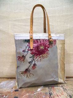 There's a lady in europe who does bags with pieces of canvas from old paintings. This reminds me of it. S