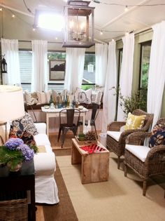 inexpensive curtain panels from IKEA, a slipcovered sofa from IKEA, a raw wood table from West Elm, and tolix bistro chairs from Pottery Barn. Rustic Sunroom, Rustic Table, Wood Table, Home Design Decor, House Design, Home Decor, Small Space Living, Small Spaces, Sunroom Curtains