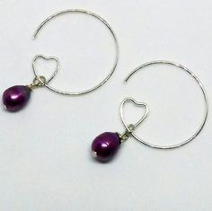 Heart and pearl earrings #silver #heart #hoopearrings #purple #pearl #love #pearljewelry #heartjewelry #romantic #earrings #texas #tx #elegant #amandanancedesigns #metro #handmadejewelry #dallas #dfw #fortworth #denton #texasartist #metroplex #madeintexas #texasgirl #texasstyle #girlthings #shoplocal #smallbusiness #metroplex #silverjewelry #texasmade #denton