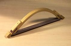 I'll show you how to make a simple bending form that presses the glued-up strips together with homemade wedges so you don't need to use a single wood clamp.