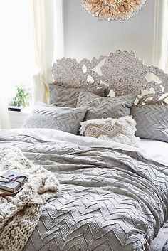 Depending on the color palette you choose for your bedroom, something like this in either gray or the ivory may look nice with the design of your furniture....Textured Chevron Duvet