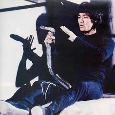 Bruce Lee with cobra in, Enter The Dragon.