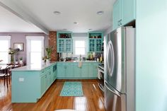 """What was a dark cramped part of the kitchen, is now a bright open airy place. The kitchen wall is gone and the bright colors of the cabinets help light up the room, as well as the additional light from the dining room area. As seen on HGTV's """"Cousins Undercover."""""""