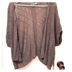 Short sleeve cardigan This is very lightweight and perfect in the summer with just a tank top!!! It's a darker grey. Even though I wear a medium-large, it fits looser so the X-Small/Small is a perfect fit! Roxy Sweaters Cardigans