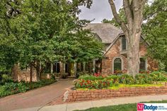 Brick home + mature trees make for a cozy front yard curb appeal