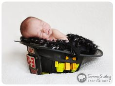 Baby in firefighters hat